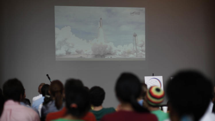 Students at Drexel University view a video projection of the launch of space shuttle Atlantis commanded by alumnus Chris Ferguson on campus Friday, July 8, 2011, in Philadelphia. Atlantis is the 135th and final space shuttle launch for NASA. (AP Photo/Matt Rourke)