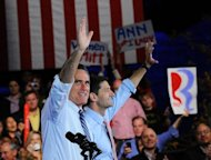 US Republican presidential candidate Mitt Romney and running mate Paul Ryan hold a campaign rally at Red Rock Amphitheatre in Morrison, Colorado, October 23. Romney said President Barack Obama&#39;s campaign was &quot;taking on water&quot; Tuesday, as the rivals barnstormed across toss-up states while seeking swing votes two weeks before election day