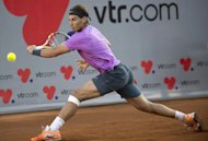 Rafael Nadal hits a return to Horacio Zeballos during the ATP Vina del Mar tournament final match, in Vina del Mar, about 120 km northwest of Santiago, on February 10, 2013. Zeballos won 6-7 (2/6), 7-6 (8/6), 6-4