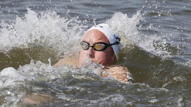 Miller of France swims backstroke to check her followers during the women's 10km open water race at the Aquatics World Championships in Kazan