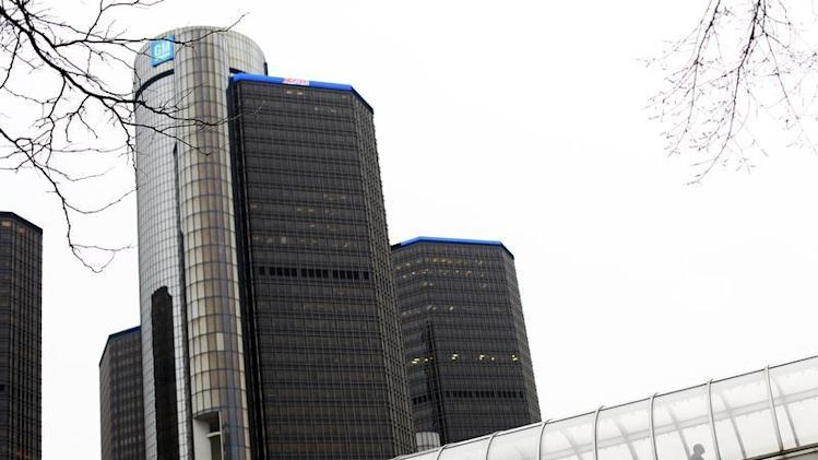 A man walks through a pedestrian bridge near the General Motors headquarters in Detroit