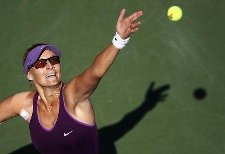 Mirjana Lucic-Baroni of Croatia serves to Simona Halep of Romania during their match at the 2014 U.S. Open tennis tournament in New York
