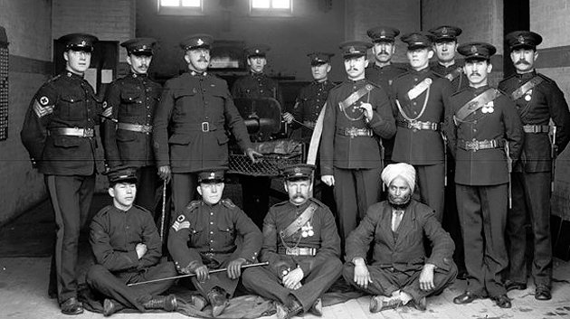 The Sikh man sitting in the lower right has never been identified. If you have a clue who it might be, you're asked to contact the British Columbia Regiment.