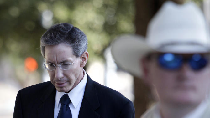"A law enforcement official stands by as Polygamist sect leader Warren Jeffs, left, arrives at the Tom Green County Courthouse, Thursday, July 28, 2011, in San Angelo, Texas. Jeffs' much-anticipated Texas trial begins in earnest Thursday, with prosecutors claiming he sexually assaulted girls he manipulated into ""spiritual marriage,"" and defense attorneys countering that their client's religious freedoms were trampled. (AP Photo/Tony Gutierrez)"