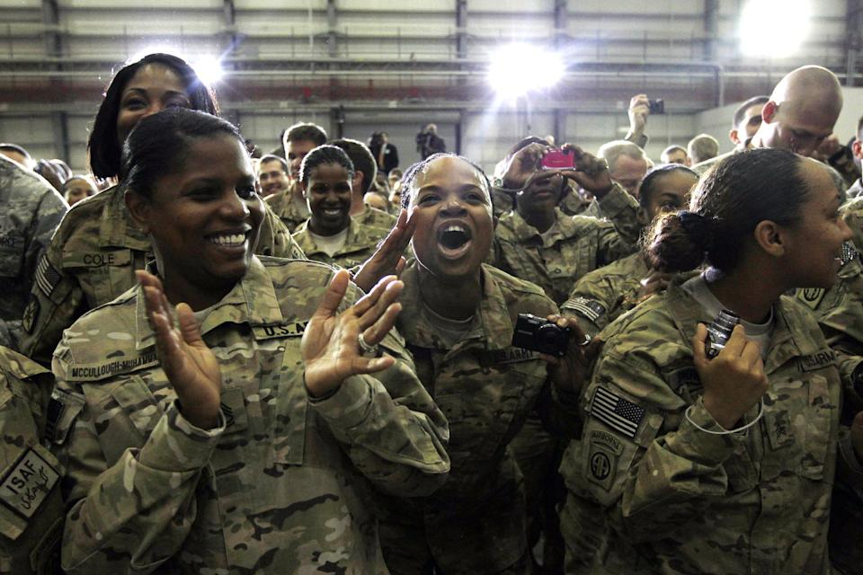 Military personnel react as President Barack Obama takes the stage to address troops at Bagram Air Field, Afghanistan, Wednesday, May 2, 2012. (AP Photo/Charles Dharapak)
