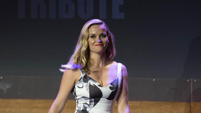 Reese Witherspoon walks on stage at the 28th American Cinematheque Award ceremony in Beverly Hills
