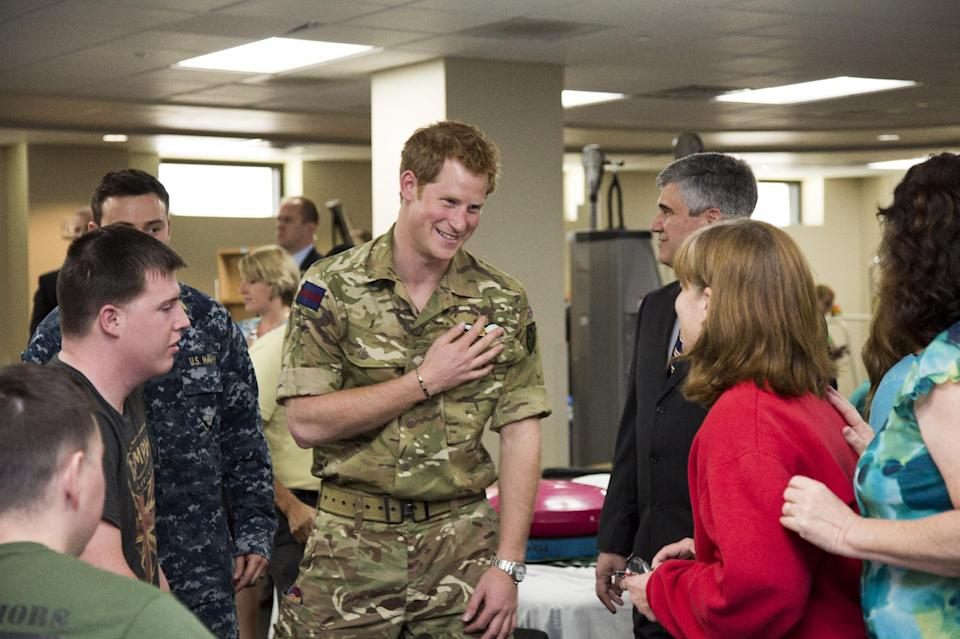 Wearing his British Army uniform, Britain's Prince Harry visits with wounded warriors undergoing physical therapy and their families at the Military Advanced Training Center at Walter Reed National Military Medical Center in Bethesda, Md., just outside Washington, Friday, May 10, 2013.   (AP Photo/J. Scott Applewhite, Pool)