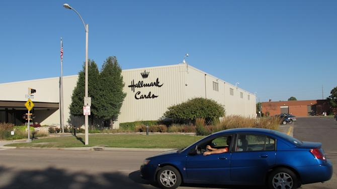 A car moves past the Hallmark Cards Inc. plant in Topeka, Kan., Tuesday, Oct. 2, 2012. The company says it plans to close the plant by the end of 2013. (AP Photo/John Hanna)