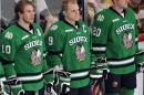 FILE - In this March 16, 2012, file photo, North Dakota hockey players wear their Fighting Sioux logo jerseys during introductions at a WCHA college hockey tournament game in St. Paul, Minn. The school adopted the nickname the Fighting Hawks on Wednesday, Nov. 18, 2015, to replace the Fighting Sioux. Students across the United States are pressuring their colleges to update mascots, mottos and building names that they say are insensitive. (AP Photo/Jim Mone)
