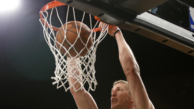 Brooklyn Nets forward Mason Plumlee (1)  dunks in the second half of a preseason NBA basketball game against the Philadelphia 76ers at the Barclays Center, Monday, Oct. 20, 2014, in New York. The Nets defeated the Sixers 99-88.(AP Photo/Kathy Willens)