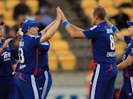 England's James Tredwell (L) celebrates with teammate Stuart Broad after New Zealand's Colin Munro is caught out during their T20 match at the Westpac Stadium in Wellington, on February 15, 2013
