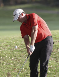 Marcus Fraser of Australia plays a shot out of the rough on the 17th hole during the second round of the Australian PGA Golf Championship at the Hyatt Regency in Coolum, Australia, Friday, Nov. 25, 2011. (AP Photo/Tertius Pickard)