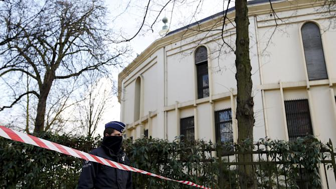 A Belgian police officer stands guard outside the Grand Mosque in Brussels