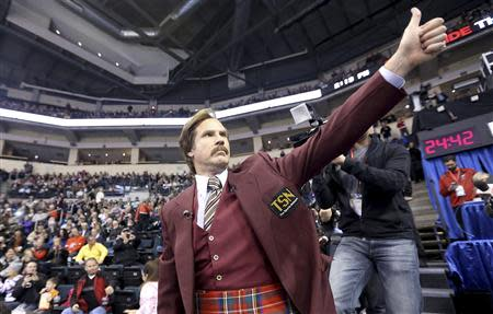 File photo of Will Ferrell as Ron Burgundy saluting the crowd at the Roar of the Rings Canadian Olympic Curling Trials in Winnipeg
