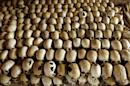 Skulls of victims of the Ntarama massacre during the 1994 genocide are lined in the Genocide Memorial Site church of Ntarama, in Nyamata on February 27, 2004