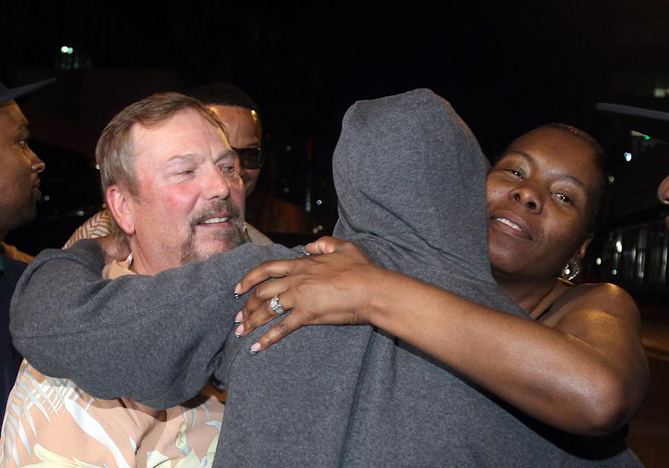 Floyd Mayweather Jr., center, is greeted by friends and family as he exits the Clark County Detention Center after serving two months of a three-month sentence in a misdemeanor domestic battery case, Friday, Aug. 3, 2012, in Las Vegas. (AP Photo/Isaac Brekken)