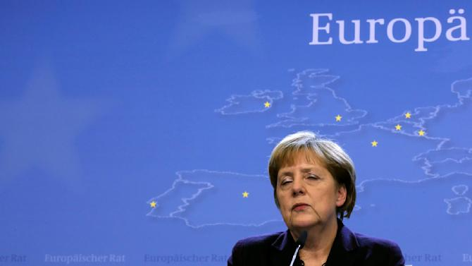 Germany's Chancellor Angela Merkel speaks at a news conference at the end of a European Union leaders summit in Brussels