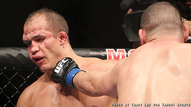Cain Velasquez lands a punch on Junior dos Santos' face during their fight at UFC 155. (Courtesy: Tracy Lee for Y! Sports)