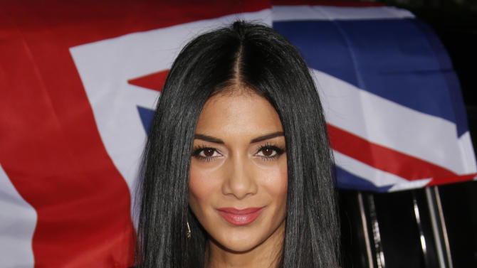 Nicole Scherzinger attends the Topshop Topman LA Opening Party At Cecconi's in Los Angeles, on Wednesday, Feb. 13, 2013 in Los Angeles. (Photo by Todd Williamson/Invision for/AP)