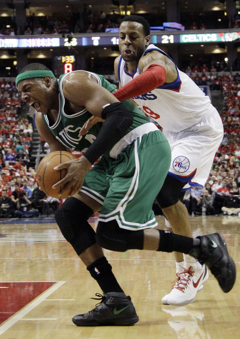 Philadelphia 76ers' Andre Iguodala, right, pressures Boston Celtics' Paul Pierce during the first half of Game 3 of an NBA basketball Eastern Conference semifinal playoff series, Wednesday, May 16, 2012, in Philadelphia. (AP Photo/Matt Slocum)