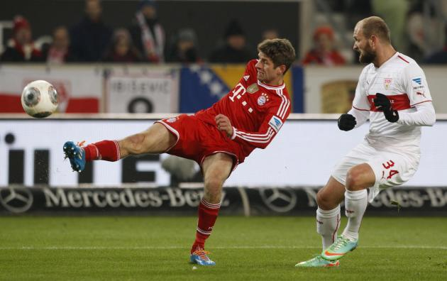 Bayern Munich's Mueller tries to score against Stuttgart's Rausch during German first division Bundesliga soccer match in Stuttgart