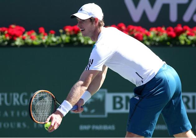 Andy Murray serves to Lukas Rosol of the Czech Republic during the BNP Paribas Open at Indian Wells Tennis Garden on March 8, 2014 in Indian Wells, California