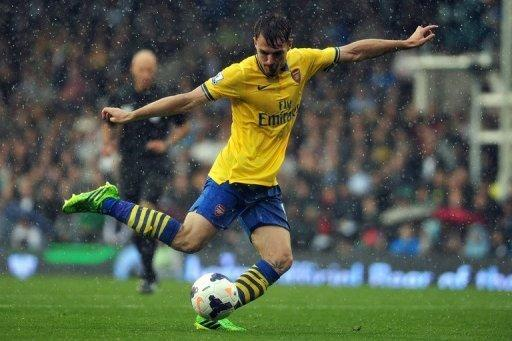 Aaron Ramsey shoots during Arsenal's game against Fulham at Craven Cottage on August 24, 2013