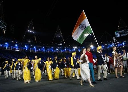 India's flag bearer Sushil Kumar holds the national flag as he leads the contingent in the athletes parade during the opening ceremony of the London 2012 Olympic Games at the Olympic Stadium July 27,