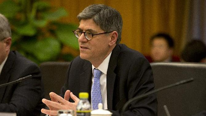 """U.S. Treasury Secretary Jacob Lew speaks at the start of a meeting with Chinese Vice Premier Wang Yang at the Zhongnanhai Leadership Compound in Beijing Monday, March 30, 2015. In the meeting Lew expressed """"deep concern"""" about the curbs in proposed bank security and anti-terrorism rules. (AP Photo/Mark Schiefelbein, Pool)"""