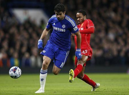 Liverpool's Sterling challenges Chelsea's Costa during their English League Cup semi-final second leg soccer match in London
