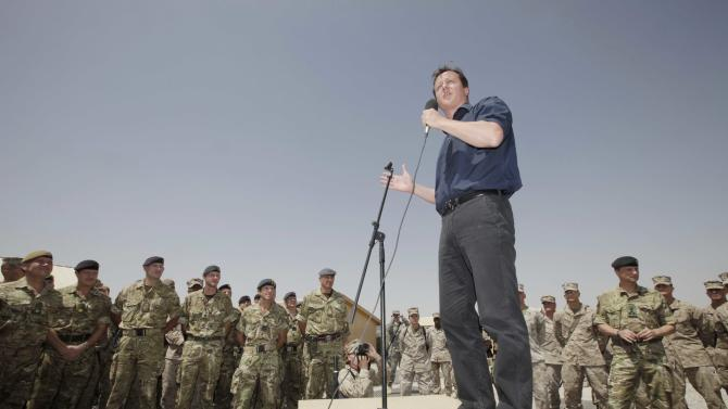 Britain's Prime Minister David Cameron, delivers a speech to British and US troops during a visit to Camp Bastion, outside Lashkar Gah, the provincial capital of Helmand province in south Afghanistan, Monday, July 4, 2011. (AP Photo/Lefteris Pitarakis, pool)