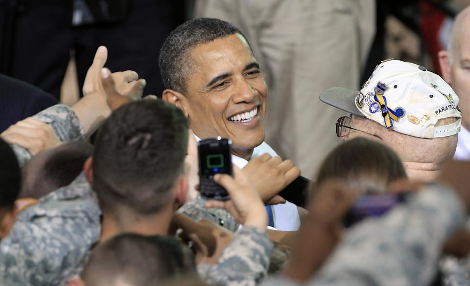President Barack Obama greets troops after speaking at Fort Campbell, Ky., Friday, May 6, 2011. Obama and Vice President Joe Biden came to Fort Campbell to address soldiers who have recently returned from Afghanistan. (AP Photo/Mark Humphrey)