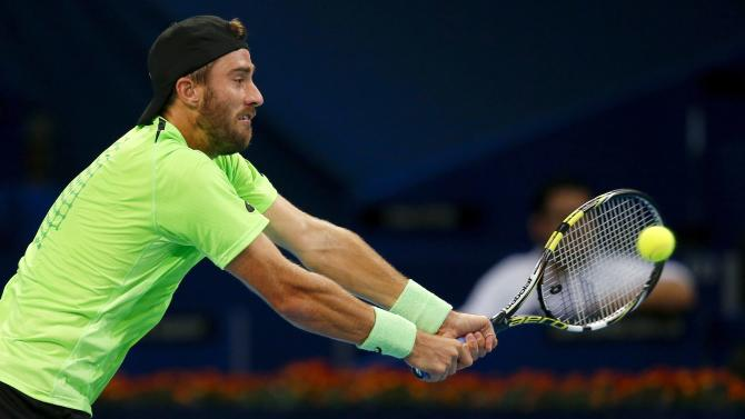 Johnson of the U.S. returns the ball during his match against Canada's Raonic at the Swiss Indoors ATP tennis tournament in Basel