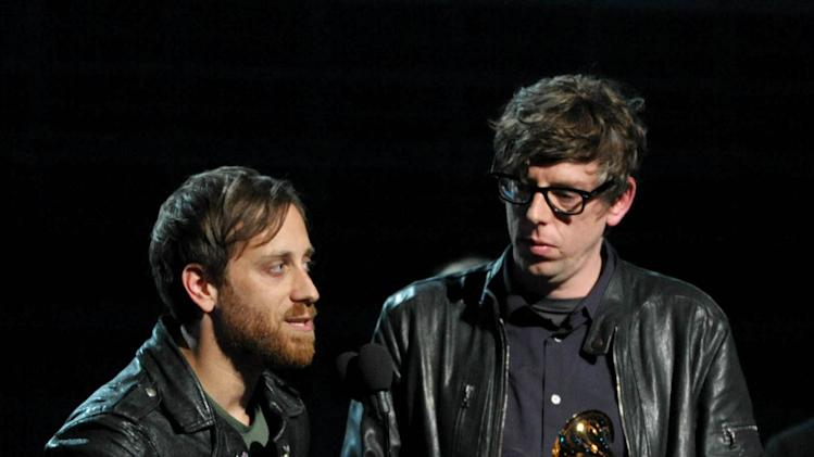 """Musicians Dan Auerbach, left, and Patrick Carney of the Black Keys accept the award for best rock performance for """"Lonely Boy"""" at the 55th annual Grammy Awards on Sunday, Feb. 10, 2013, in Los Angeles. (Photo by John Shearer/Invision/AP)"""