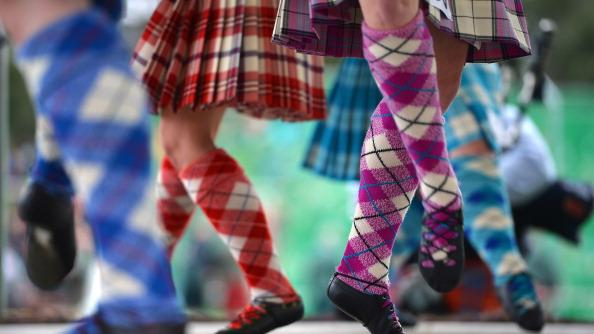 Highland dancers compete at the Braemar Highland Games at The Princess Royal and Duke of Fife Memorial Park on September 1, 2012 in Braemar, Scotland. The Braemar Gathering is the most famous of the Highland Games and is known worldwide. Each year thousands of visitors descend on this small Scottish village on the first Saturday in September to watch one of the more colorful Scottish traditions. The Gathering has a long history and in its modern form it stretches back nearly 200 years. (Photo by Jeff J Mitchell/Getty Images)