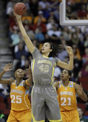 Baylor's Brittney Griner (42) catches a pass over Tennessee's Glory Johnson, left, and Vicki Baugh, right, during the first half of an NCAA women's college basketball tournament regional final, Monday, March 26, 2012, in Des Moines, Iowa. (AP Photo/Charlie Neibergall)