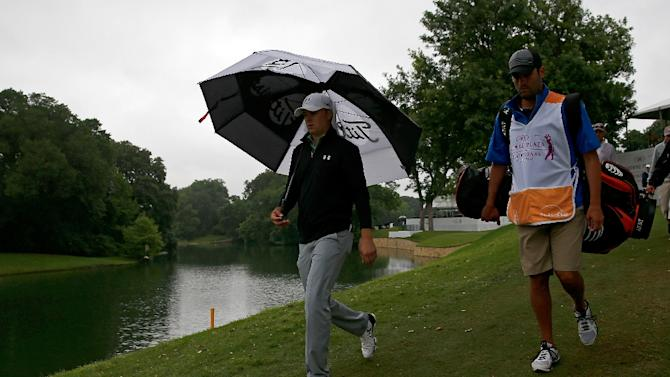 Jordan Spieth and his caddie walk the fairway during the second round of the Crowne Plaza Invitational at the Colonial Country Club on May 22, 2015 in Fort Worth, Texas