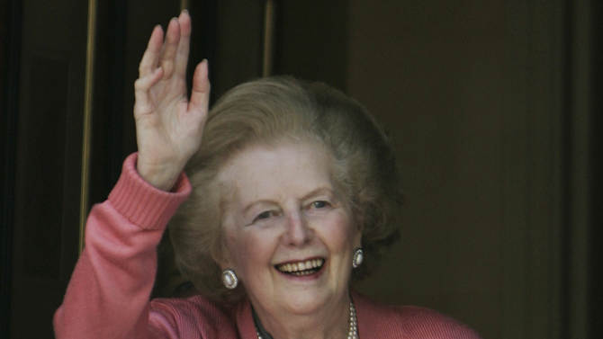 """FILE- Former British Prime Minister Margaret Thatcher, gestures to members of the media following her return home from hospital suffering from a broken arm, in central London, in this file photos dated Monday June 29, 2009.  87-year old Thatcher is recuperating at an unnamed hospital, Friday Dec. 21, 2012, after an operation to remove a bladder growth, which was """"completely satisfactory"""", according to adviser Tim Bell, who did not give further details. (AP Photo/Lefteris Pitarakis, File)"""