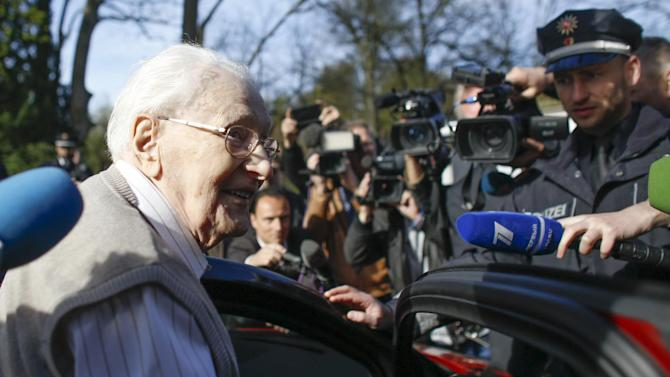 Former SS guard Oskar Groening is surround by media as he arrives at the back entrance of the court hall prior to a trail against him in Lueneburg, northern Germany, Tuesday, April 21, 2015. Groening, 93, is accused of helping to operate the death camp Auschwitz in Nazi-occupied Poland between May and June 1944, when some 425,000 Jews from Hungary were brought there and at least 300,000 were almost immediately gassed to death. (AP Photo/Markus Schreiber)
