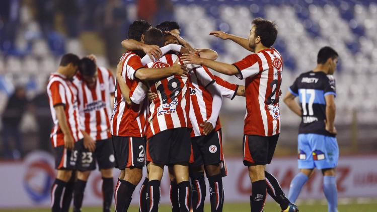 Players of Uruguay's River Plate celebrate after their Copa Sudamericana match against Chile's Universidad Catolica in Santiago