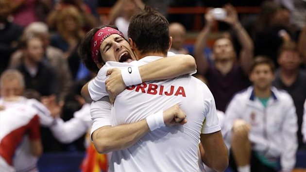 Serbia's Ilija Bozoljac (L) and Nenad Zimonjic celebrate after defeating United States' Mike Bryan and Bob Bryan during their Davis Cup doubles quarter-final tennis match in Boise, Idaho (Reuters)