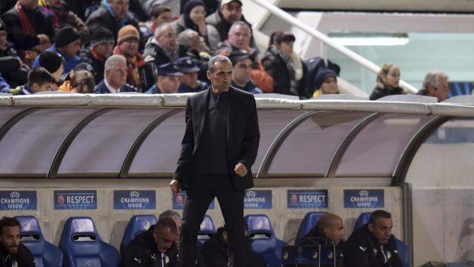 APOEL Nicosia coach Donis watches his team play Barcelona during their Champions League Group F soccer match at GSP Stadium in Nicosia