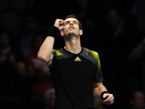 Murray of Britain celebrates defeating Berdych of Czech Republic in their men's singles tennis match at the ATP World Tour Finals in London