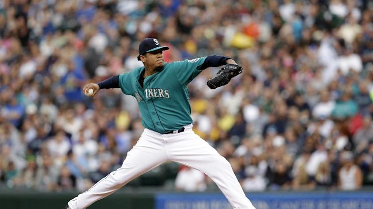 Seattle Mariners starting pitcher Felix Hernandez in action against the Washington Nationals in a baseball game Friday, Aug. 29, 2014, in Seattle. (AP Photo/Elaine Thompson)