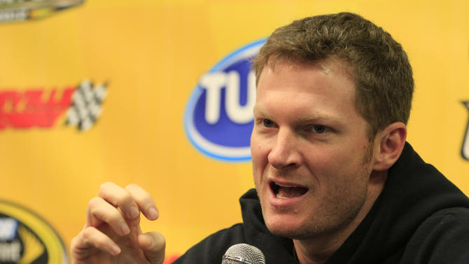 Dale Earnhardt Jr., gestures during a news conference prior to his first practice since recovering from concussions at Martinsville Speedway in Martinsville, Va., Friday, Oct. 26, 2012. (AP Photo/Steve Helber)