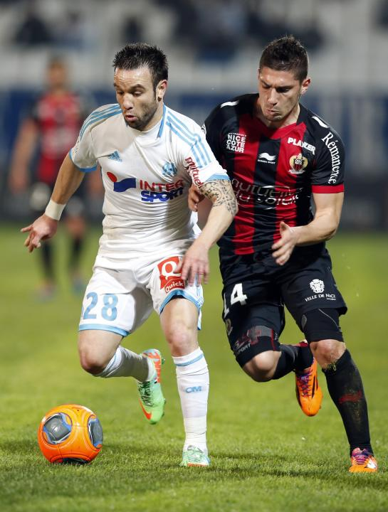 Olympique Marseille's Valbuena challenges Nice's Pied during their French Ligue 1 soccer match in Marseille