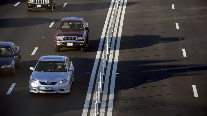 Automobiles drive on Interstate 495 South, the Capital Beltway, left, while soon to be opened express lanes, right, wait for traffic near Tysons Corner in Fairfax County, Va., Friday, Nov. 9, 2012. The $2 billion, 14-mile, decade-in-the-making Express Lanes are set to open Nov. 17. The four Express Lanes, two northbound and two southbound, supplement the existing eight lanes on the Virginia side of the Beltway. (AP Photo/Cliff Owen)