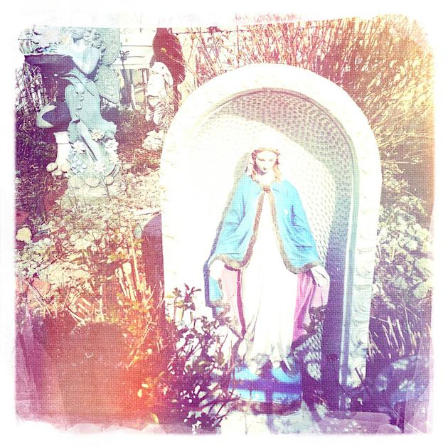 The Virgin in front of the house