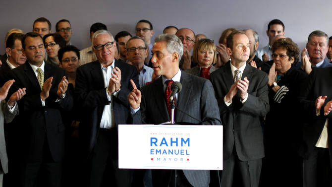 Chicago mayoral candidate Raham Emanuel, center, is applauded during his remarks at a campaign stop with leaders of the lesbian, gay, bisexual, and transgender community in Chicago on Friday, Jan. 28, 2011. (AP Photo/Charles Rex Arbogast)