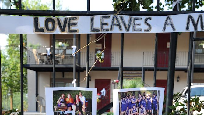 An impromptu memorial is seen outside the apartment of slain Mercer University law school graduate Lauren Giddings, on Thursday, July 7, 2011, in Macon, Ga. Officials have confirmed that a dismembered body found near the apartment complex is that of Giddings, 27, who had been reported missing days before police discovered her body June 30. (AP Photo/Erik S. Lesser)